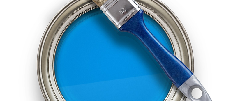 Blue paint and brush